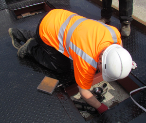 Maintenance being performed on a pit-mounted weighbridge at a scrap metal merchant in Sunderland