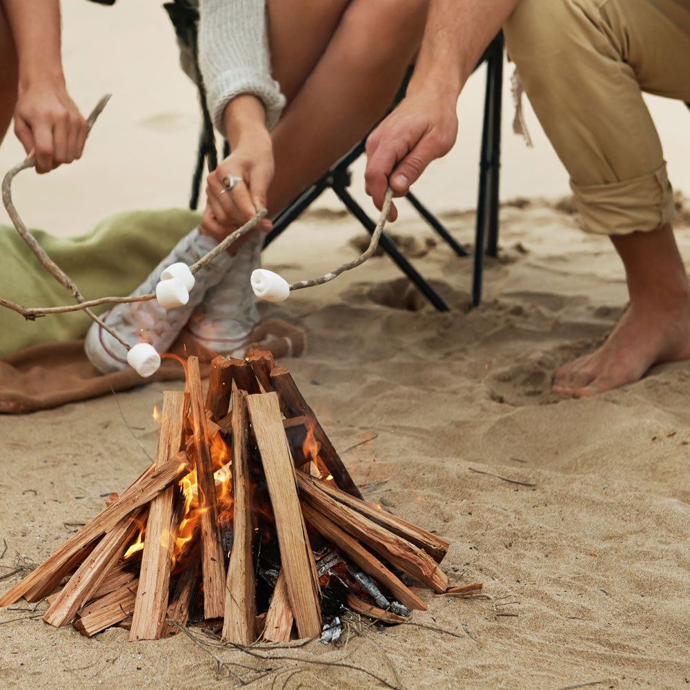 camp counselors making campfires