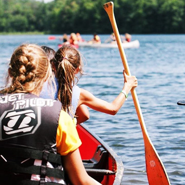 Camp Counselors sailing in camp lake